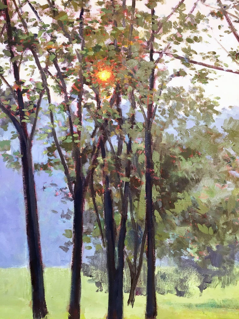 Hazy Woodstock, by Elissa Gore, 2007. Oil on canvas, 25 x 60 inches. A serene and peaceful panoramic view of a lush green field with woods in the background. In the foreground are a grove of trees where the orange sun peeps through. Rich colors of