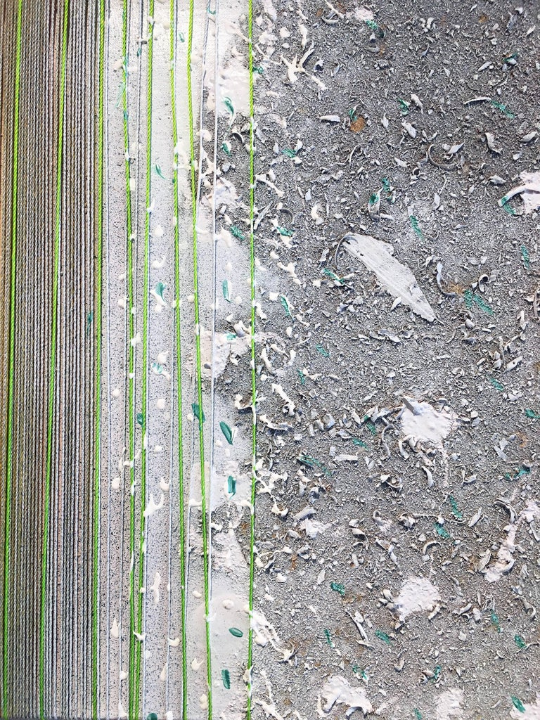 'Auseinarht (out a night)' by Stanley Boxer, 1997, Mixed media on canvas, 14 3/4 x 47 3/4 inches. Gray is the predominat color in this mixed media piece with a bright strip of greens and yellows on the left mimic the verticle lines created from