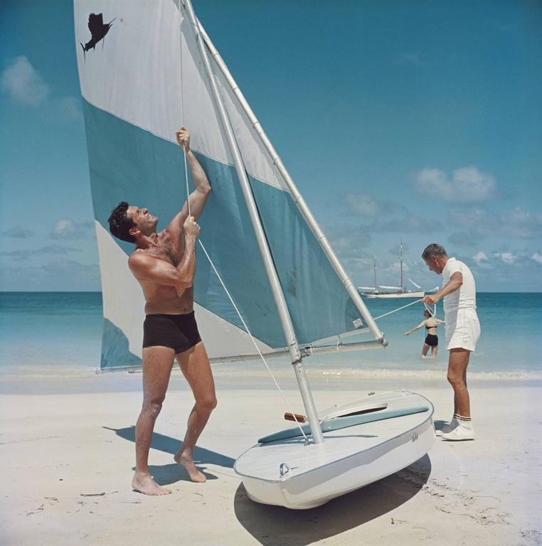 'Boating In Antigua' 1961 (Slim Aarons Estate Edition) - Photograph by Slim Aarons