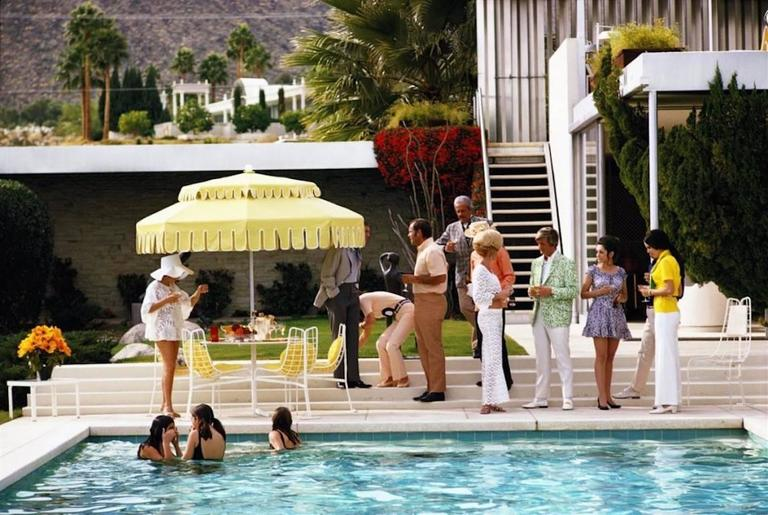 Slim Aarons Color Photograph - 'Poolside Party' Palm Springs (Estate Stamped Edition)