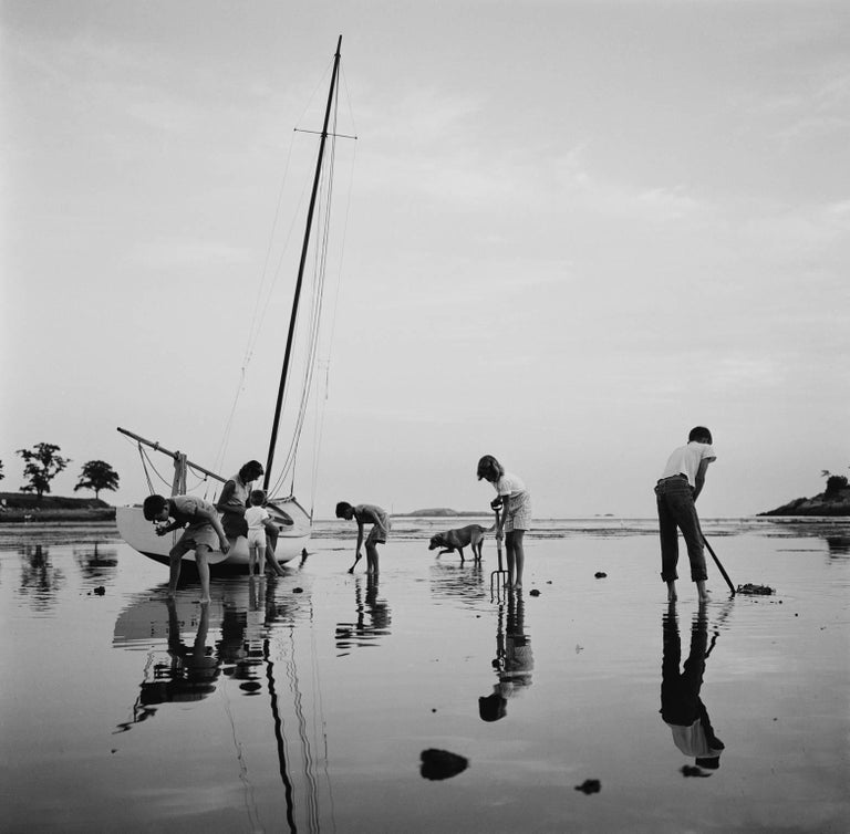 'Digging For Clams' Black Beach (Slim Aarons Estate Edition) - Photograph by Slim Aarons