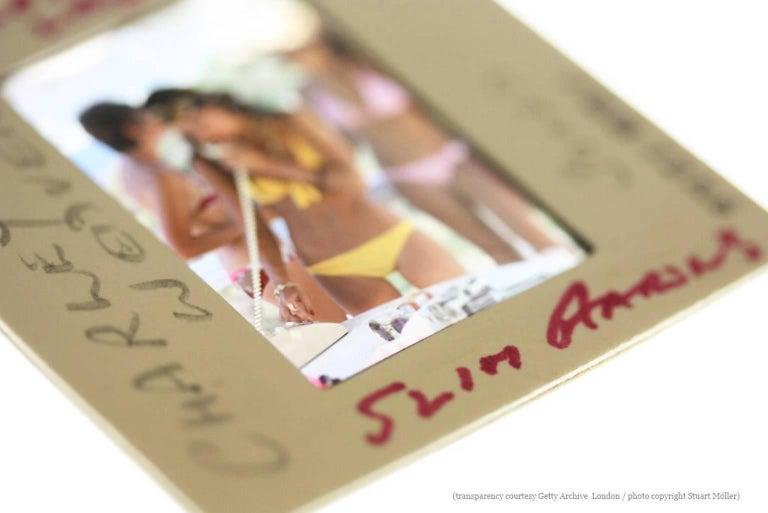 'Speedboat Landing'  (Slim Aarons Estate Edition) - Black Color Photograph by Slim Aarons
