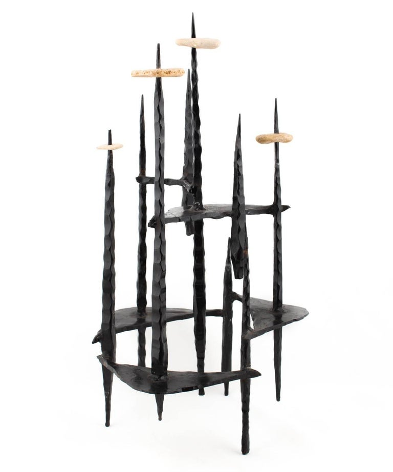 Hand Forged Iron and Drilled Stone Candelabra  Holocaust Memorial Judaic Menorah Sculpture  David Palombo was an Israeli sculptor and painter. He was born in Turkey and immigrated to the Land of Israel with his parents in 1923. In 1940 he began his
