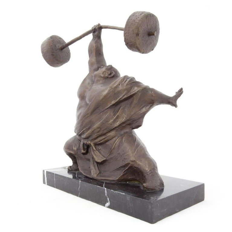 Chinese Contemporary art sculpture. Weight lifter, body builder with bar bell. Yaohui Wu was born on November 2, 1964 in China. Passionate about painting, calligraphy and sculpture, he turned to boxwood carving under the tutelage of master Jinshun