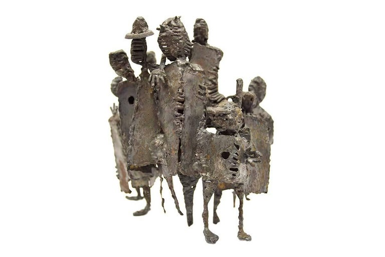 In this bronze sculpture the artist (unknown) has welded together a group of figures into a unified piece. These figures take on animal, and human characteristics, which is evident in the shape of their bodies and faces. Neo-Dada Abstract Sculpture: