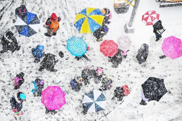 Mitchell Funk Abstract Photograph - Pink Umbrellas in the Snow, New York City