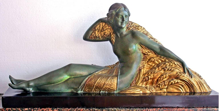 Beautiful  large work and it's very heavy.  Bronze with green and gold patina. It is very heavy