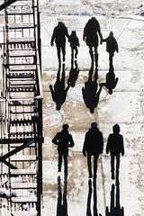 Silhouetted Figures on New York Street