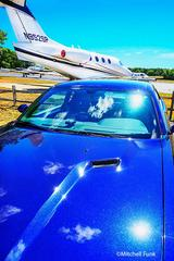 Blue Car and Private Jet