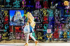 Women in from of Basquiat like wall