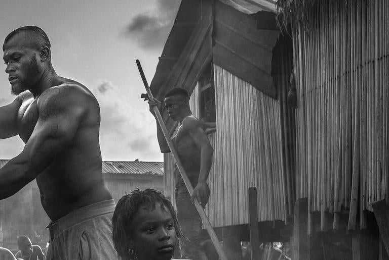 A Ship Called Dignity - Contemporary Photograph by David Yarrow