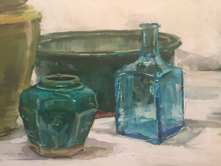 Painted from life, an array of vibrant cool jewel tone vessels placed on a pale bright backdrop.  A resident of East Hampton, New York, Beth Rundquist paints portraits, still lifes, figures and plein air landscapes. Its refreshing to see an