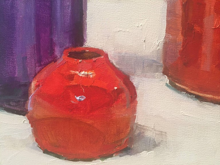 Painted from life, three vibrant vessels; two red, one purple.   A resident of East Hampton, New York, Beth Rundquist paints portraits, still lifes, figures and plein air landscapes. Its refreshing to see an academically trained painter, who borrows