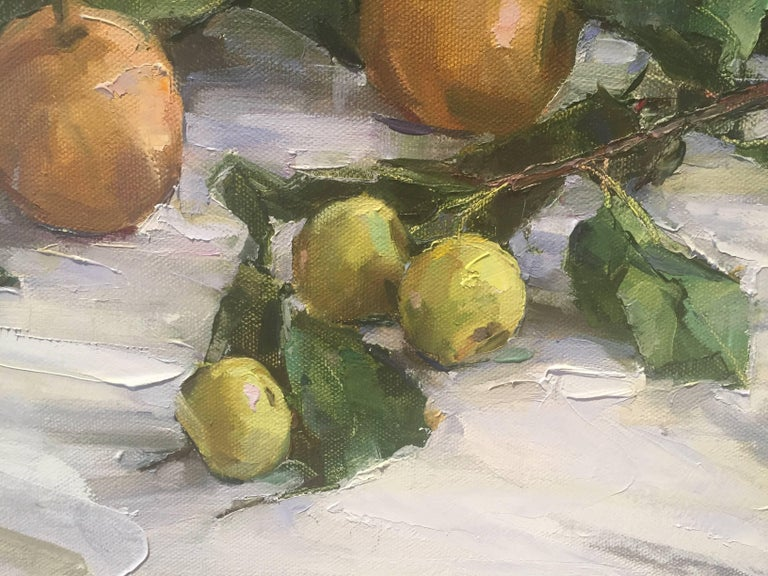 Painted from life, a branch of green fruit, perhaps pears, scattered on top of a white cloth.  A resident of East Hampton, New York, Beth Rundquist paints portraits, still lifes, figures and plein air landscapes. Its refreshing to see an