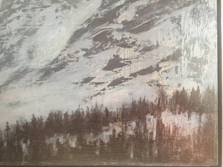 An oil painting on newsprint, adhered to canvas. Straus depicts an image of an arctic landscape, daunting mountain peaks swept with a blanket of snow poke upward toward the misty horizon. A bright, round sun gleams orange and yellow, and dissipates