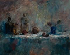 Still life with fruit and glass bottles