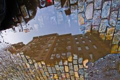 Yancy Clete Christopher - Crosby Street, 2010 buildings reflecting in a water puddle New York in Soho