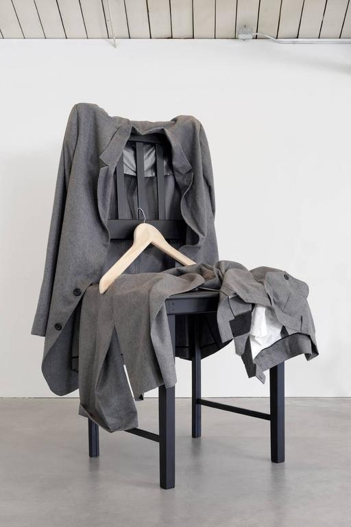 Sidney Russell - Grey Flannel Suit on Chair 1