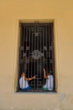Color Photograph -- Two Women at the Gate, Havana
