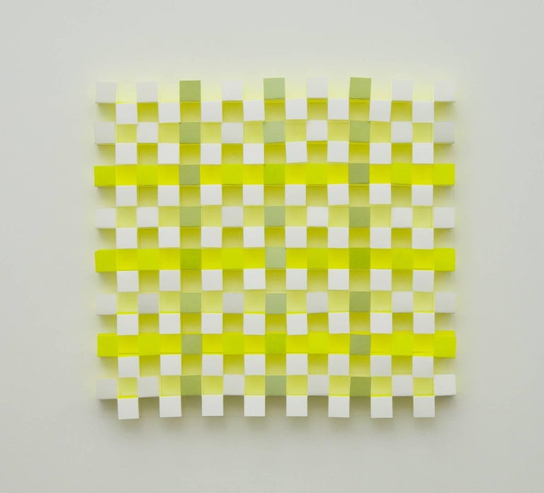 Joan Grubin creates dimensional installations, objects, and smaller wall works that revolve around a collaboration between the physical presence of pigment on paper and the visible but immaterial partners of reflected color, cast shadows, and