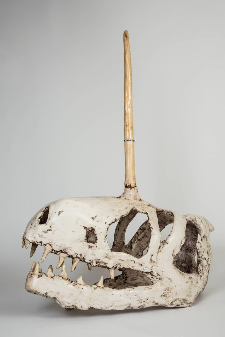 Joshua Goode Figurative Sculpture - Adolescent Unicorn T-Rex Skull with 'No Fear' Bedazzlement