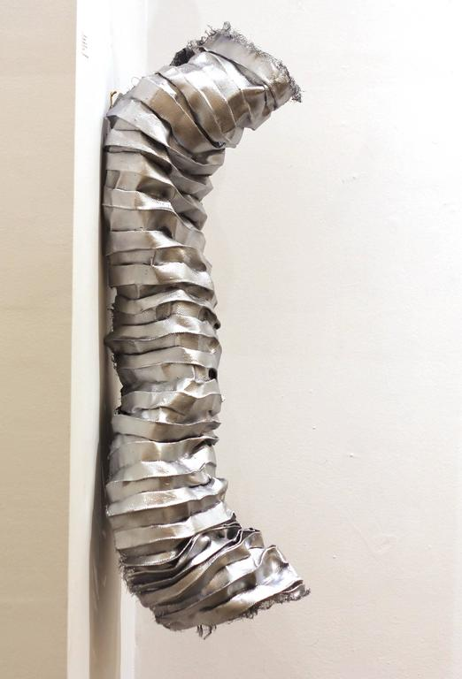 Atticus Adams' organically composed modern metal sculptures embody the transformative power of art, illustrating the creation of beauty, meaning, and emotional impact from industrial materials. Using mostly aluminum mesh—generally found in screen