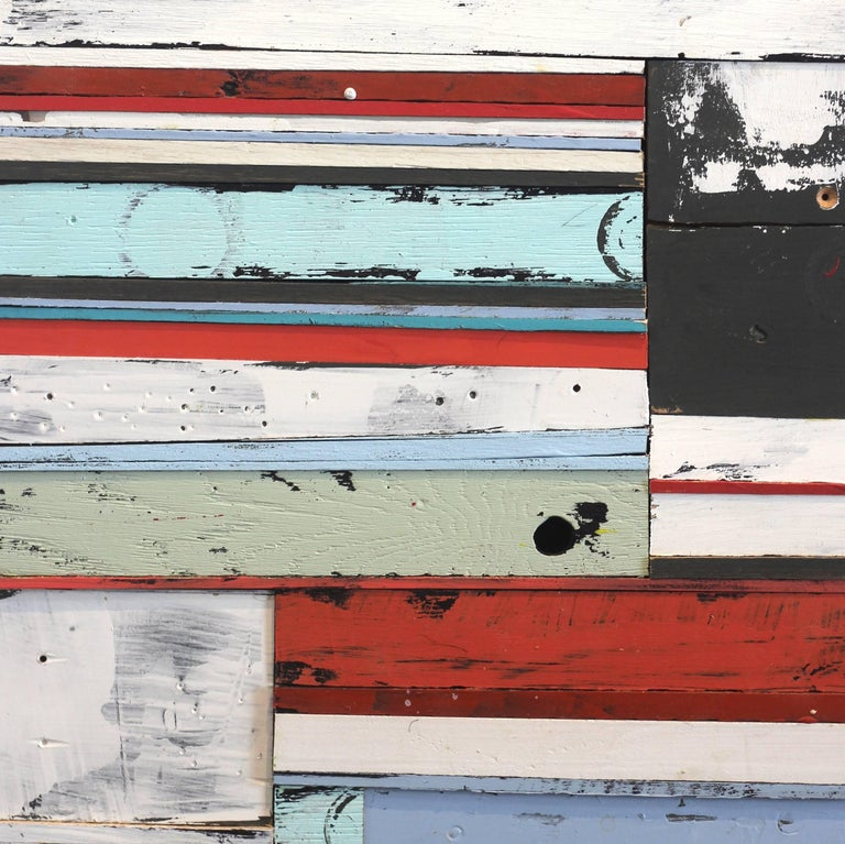 This 20 inch tall by 15 inch wide original mixed media artwork by Rebecca Klundt is a assemblage of found wood, finished with layers of acrylic paint, resulting in a geometric abstraction artwork. It is mounted on a wood panel, wired and ready to