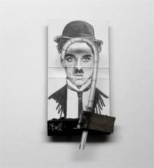 Charlie Chaplin- figurative black and white portrait on matchbox