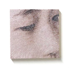 Fragment #2- contemporary close up portrait of torn and pasted photograph