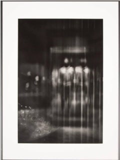 black and white photography of blurred urban landscape with man