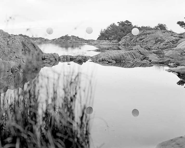 Ole Brodersen Landscape Photograph - Rubber string and rocks #01 - black and white contemporary landscape photo water