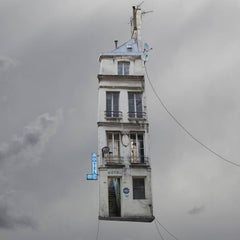 Max -whimsical grey color photography of a Parisian hotel flying house