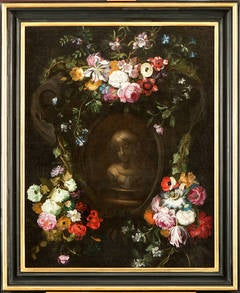 Swags of flowers adorning a grisaille cartouche with a bust of a girl