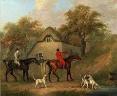 A huntsman on horse back accompanied by fox hounds in a landscape