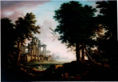 A wooded landscape with a view of classical ruins