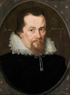 Portrait of a Gentleman wearing a black embroidered doublet and white straight-f