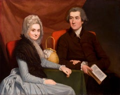 Portrait of a Gentleman and lady at a table