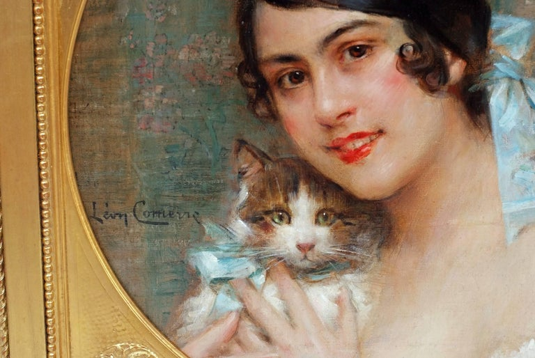 Léon François COMERRE (1850-1916) Young Lady With Kitten Oil on canvas signed left Old frame re-gilded with leaves Dim canvas : 50 X 50 cm Dim frame : 61 X 61 cm  COMERRE Léon François (1850-1916) French painter born 10 October 1850 in Trélon (North