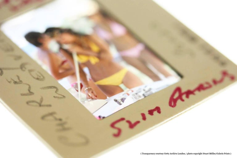 'Sunbathing On Capri' Slim Aarons Estate Print - Brown Nude Photograph by Slim Aarons