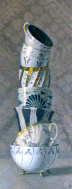 """Elegant Still Life of Seven Stacked White, Blue, and Gold Cups"""