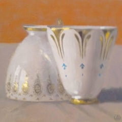 """Elegant Still Life of Two White and Gold Cups on Orange"""