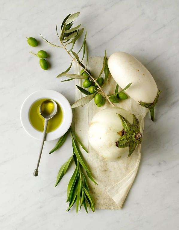 Beth Galton Still-Life Photograph - Still Life of White Eggplants and Olive Oil