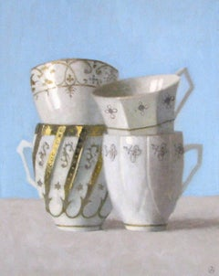 """Elegant Still Life of Four Gold and White Cups on Bright Blue"""