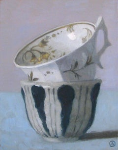 """""""Elegant Still Life of Two Stacked Cups, One with Dark Blue Stripes"""""""