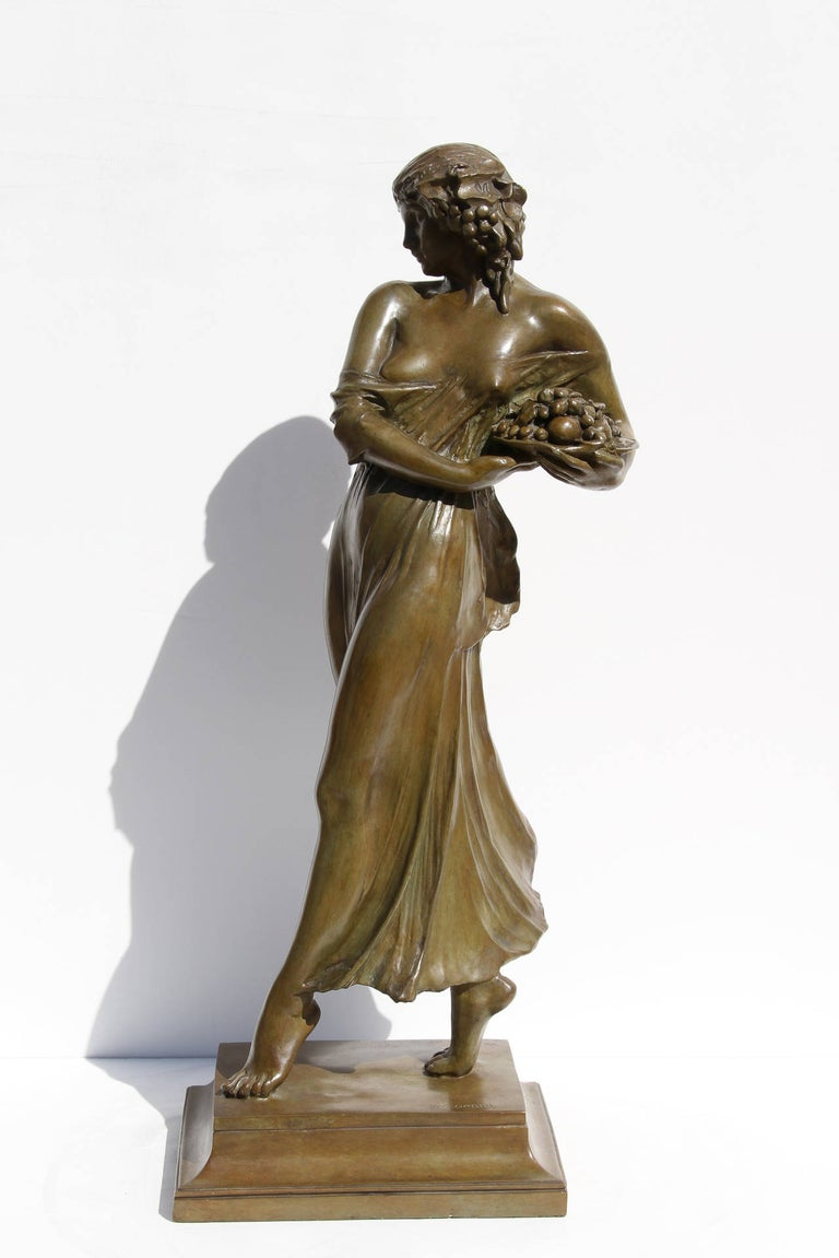 Mario Joseph Korbel Figurative Sculpture - Woman Carrying Grapes