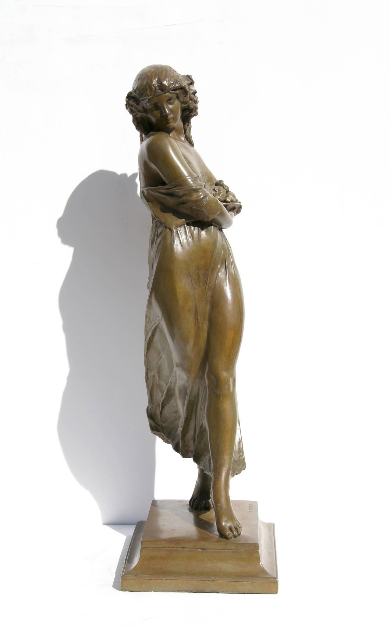 Woman Carrying Grapes - Sculpture by Mario Joseph Korbel