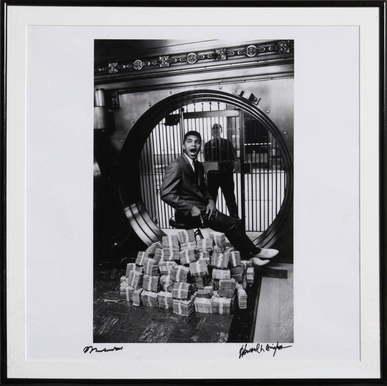 Howard Bingham Black and White Photograph - Muhammad Ali Sitting on a Million Dollars