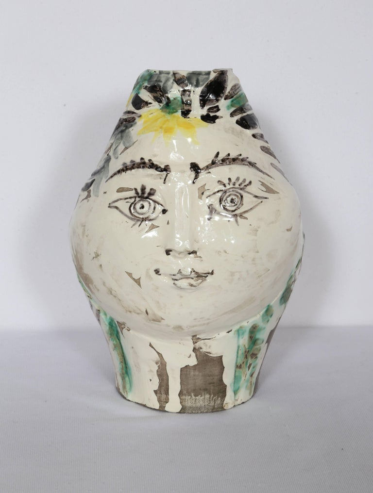 Artist: Pablo Picasso, Spanish (1881 - 1973) Title: Woman's Head, Decorated with Flowers (Ramie 237) Year: 1954 Medium: A.R. White Earthenware Clay Ceramic Pitcher, numbered on bottom Edition: 12/100 Size: 9  x 5.5  x 6 in. (22.86  x 13.97  x 15.24