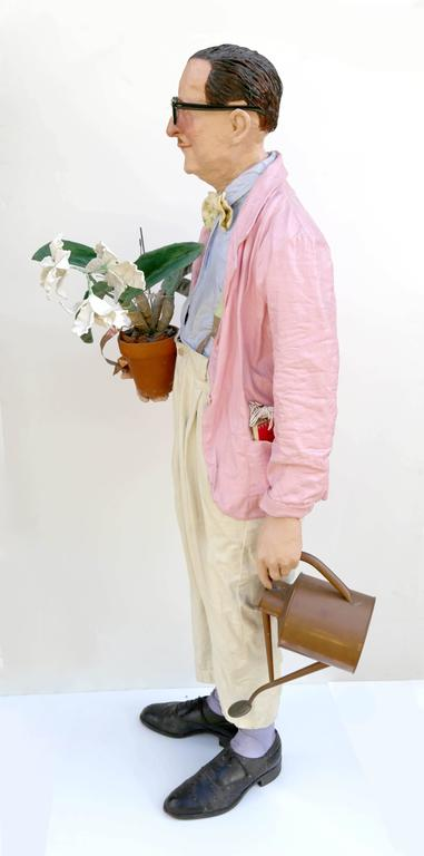Artist: Kay Ritter Title: Janitor Medium: Papier-mache with metal watering can, glasses, papier-mache flowers Year: circa 1983 Size: 57  x 24  x 14 in. (144.78  x 60.96  x 35.56 cm)