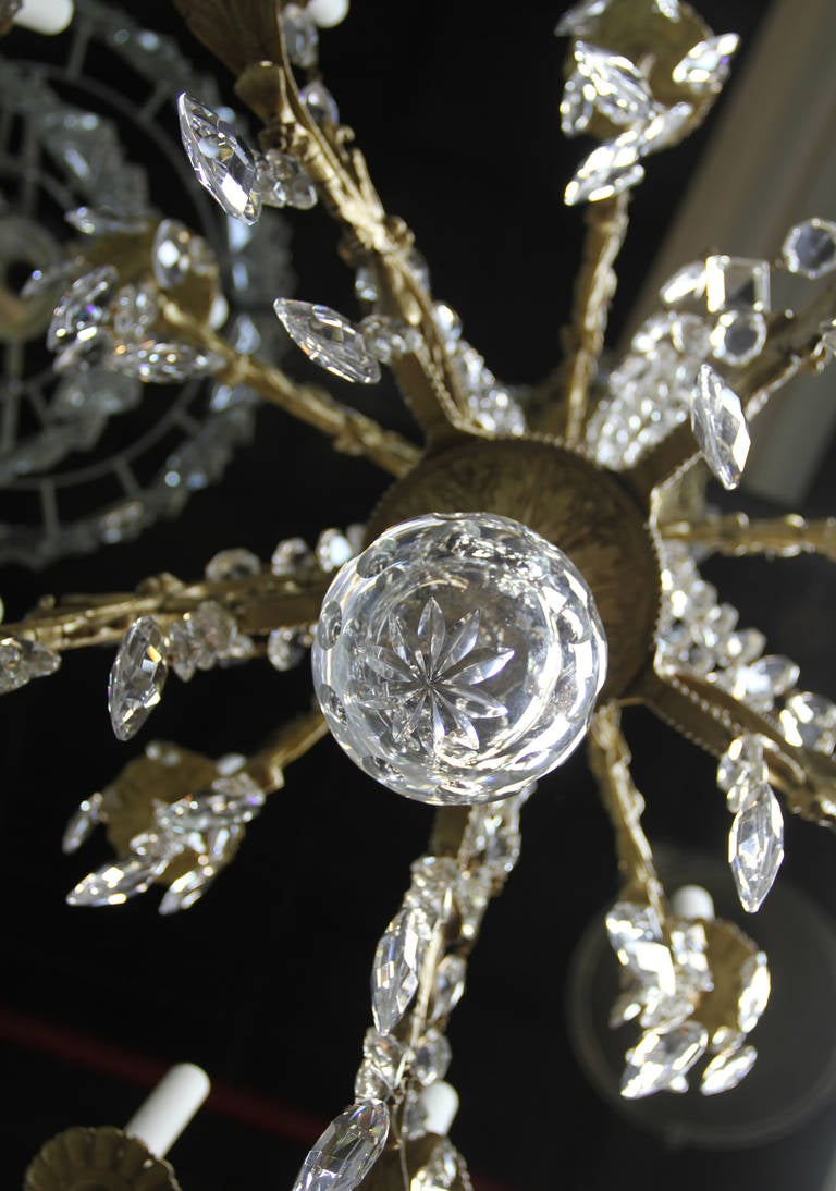 This gorgeous chandelier is from circa 1910 with 24 candle bulbs an a multitude of gemini cut crystal. Believed to be French in origin, and will be stunning in any space. Has been recently rewired to last for many years to come.